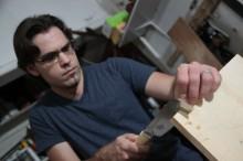 Brian sawing wood