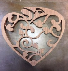 heart shaped scroll saw trivet by Feisty Dog Woodcrafts
